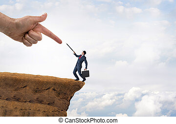 business challenge concept businessman pushed to the edge of...