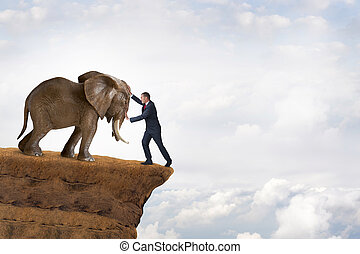 business strength concept businessman pushed to the edge of...