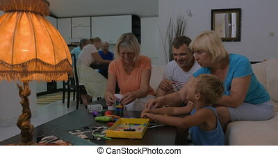 Child spending leisure time with dad and grandmothers -...