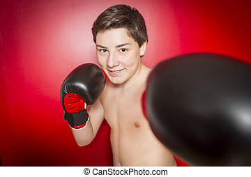 Close-up photo of a boxer with red gloves