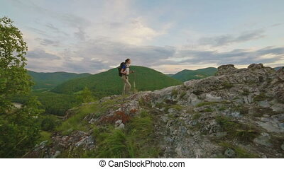 Hiker woman is walking mountain, - Hiker young woman walking...