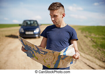 Reading the Map - Stock Image - Photo of a traveler parked...