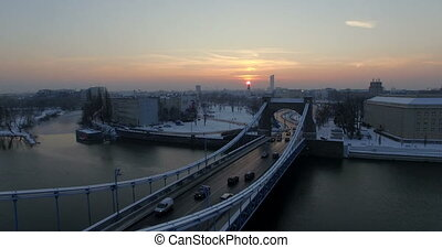 Aerial: Grunwald bridge in Wroclaw during winter, Poland