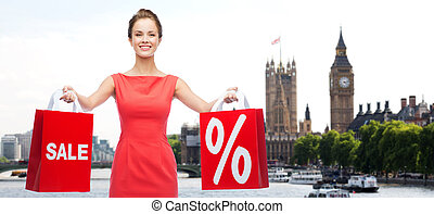 woman with shopping bags over london city - sale, discount,...