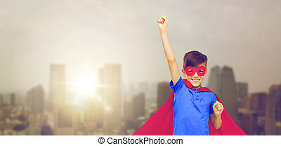 boy in red superhero cape and mask showing fists - carnival,...