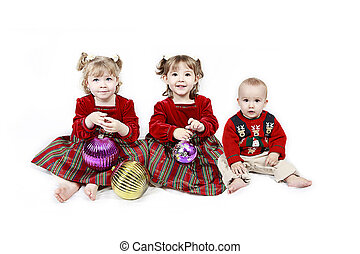 Three Children isolated on white in christmas outfits -...