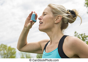 woman who have a asthme crisis outside - A woman who have a...