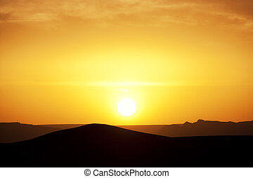 Sunset in the Sahara desert. Concept of holiday and...