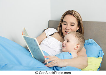 Mother reading a story to her son