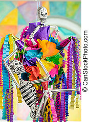 Day of the dead pinata with skeletons Dia de Muertos -...