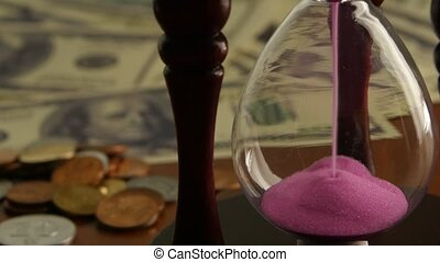 Pink sand hourglass. Close up - Pink sand hourglass, sand...