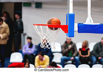 Abstract sport background with basketball hoop. Sport equipment for team game. The ball enters the basket.