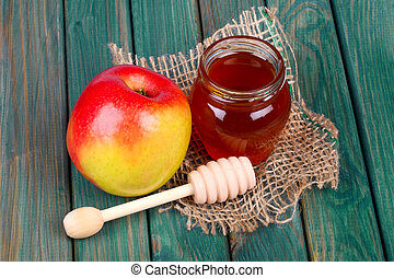 Honey and apple on wooden table - Honey and apple on rustic...