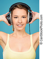 cloudless mood - Modern girl enjoys listening to music in...