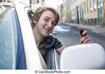 Teenage boy and new driver behind wheel of his car