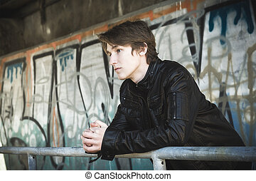 teenager depressed inside a dirty tunnel - A teenager...