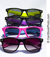 a few collorful sun glasses