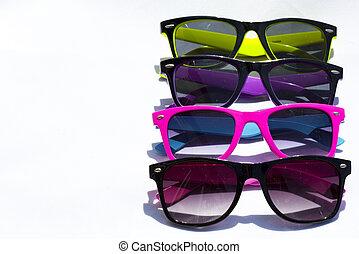 a few collorful sun glasses