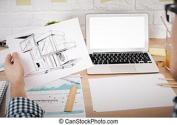 Architect evaluating project mockup - Architect evaluating...