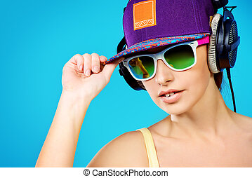 trendy youth - Modern young woman enjoys listening to music...