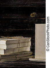 old book on wooden background - stacked books on a wooden...