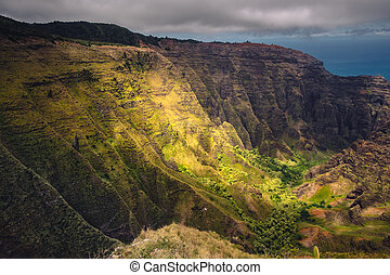 Dramatic landscape view of Na Pali coastline, cliffs and...