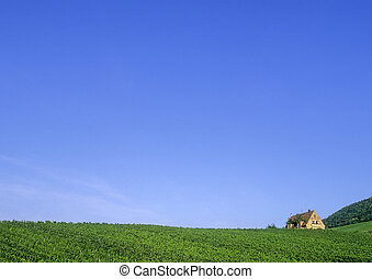 Wide landscape  - Wide landsacpe with open sky and house.