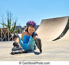 Girl riding on roller skates in skatepark. - Child riding on...