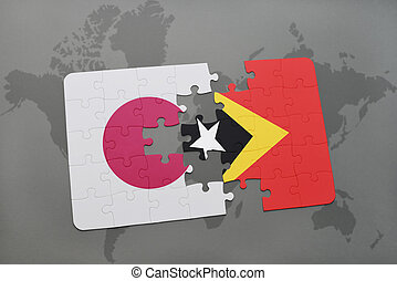 puzzle with the national flag of japan and east timor on a world map background.