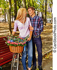 Couple with retro bike in the park - Young couple with...