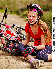 Bikes cycling girl wearing helmet fell off bike.