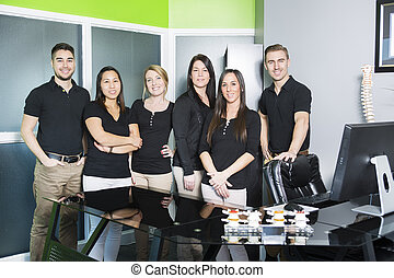 Happy business team at the office - A Happy business team at...