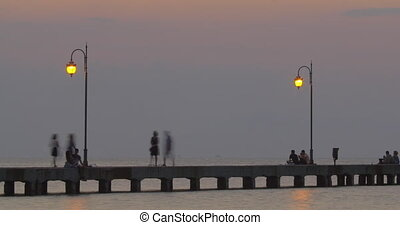 People Resting on Sea Pier - Timelapse of people on the...