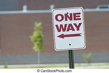 one way sign on the road