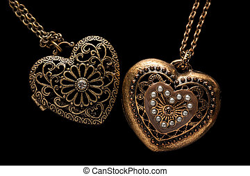 Heart-shaped necklace on black background