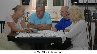 People at home discussing some issue using digital tablet
