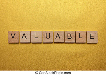 Valuable concept - Wooden letters spelling VALUABLE on...