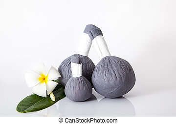 Herbal compress ball and flower for spa treatment isolated...