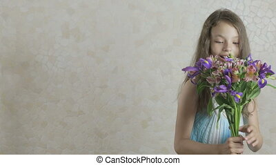 Beautiful girl rejoices donated bouquet of flowers and...