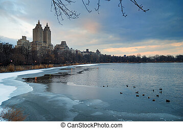 Central Park in Winter, New York City, with ice lake and...