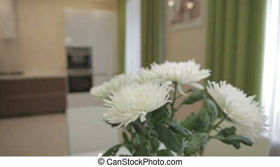 Beautiful bouquet of white chrysanthemums in home interior -...