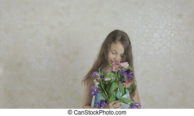 Beautiful girl rejoices donated bouquet and scatter flowers....