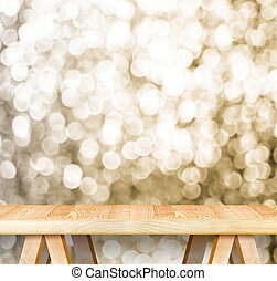 Empty perspective wooden table with sparkling bokeh wall...