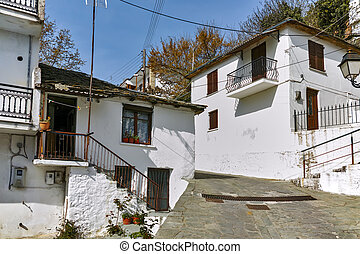 village of Panagia, Thassos - Stone street and Old house in...