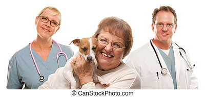 Happy Senior Woman with Dog and Veterinarian Team - Happy...
