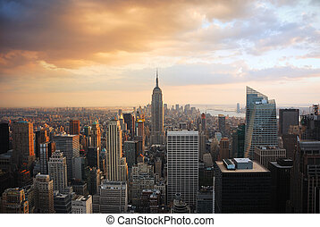 New York City Manhattan skyline at sunset with empire state...