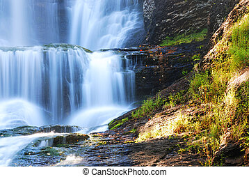 Waterfall closeup in details with rocks. From Digman Falls,...