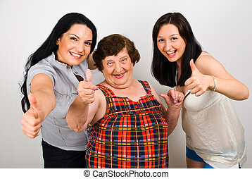 Happy grandma with granddaughters give thumbs - Happy...