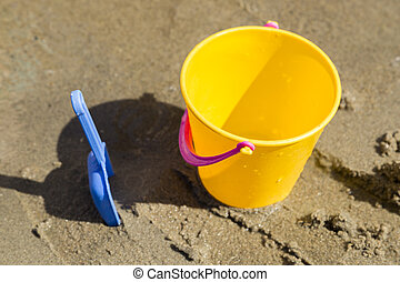 Toy Spade and Bucket in Sand