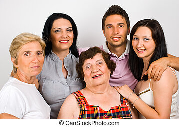 Happy family group with grandma,mother and three children...